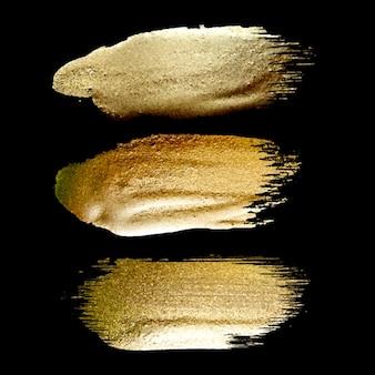 Collezione di set di pennellate di vernice dorata fatta a mano