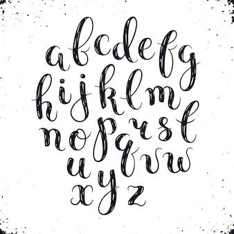 Lettere fatte a mano. alfabeto scritto a mano con macchie di acquerello