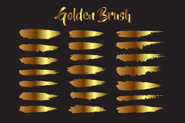 Insieme di tratti di pennello dorato macchia acquerello fatto a mano