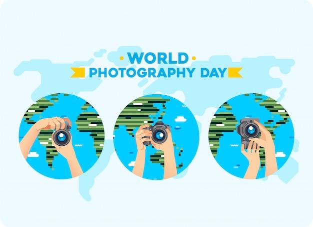 Mani che portano la fotocamera digitale con diverse pose e mappa del mondo come sfondo. illustrazione della giornata mondiale della fotografia. utilizzato per poster, immagine del sito web e altro