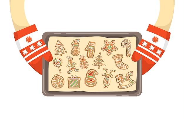 Mani in guanti che tengono vassoio con biscotti fatti in casa. pan di zenzero tradizionale di vacanza. illustrazione