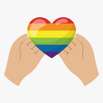 Le mani tengono un cuore nei colori dell'arcobaleno lgbt sui palmi delle mani. un simbolo di tolleranza e solidarietà
