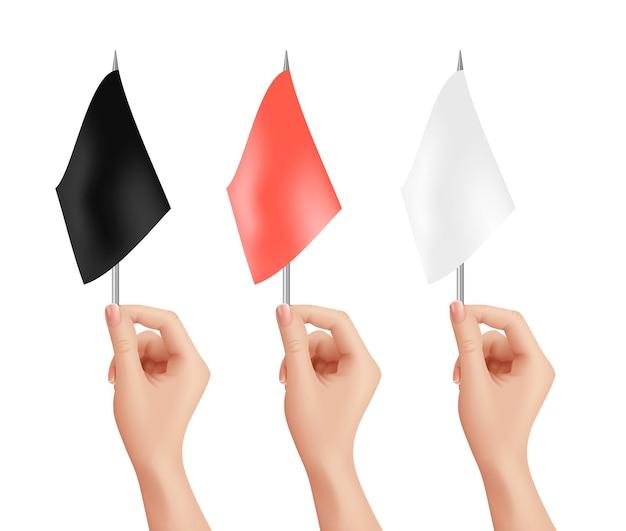 Mani che tengono le bandiere impostate