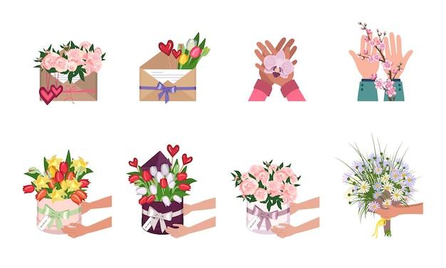 Mani che tengono i fiori