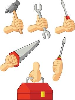Mani che tengono martello, cacciavite, chiave inglese, sega e cassetta degli attrezzi