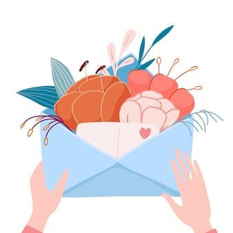 Mani che tengono, apertura, confezione busta con bouquet di bellissimi fiori e piccolo biglietto di auguri, romantica cartolina in stile boho,