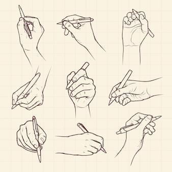 Mani che tengono insieme della raccolta disegnata a mano della penna