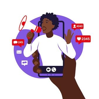Mani che tengono smartphone con una ragazza africana che grida in altoparlante influencer marketing promozione sui social media