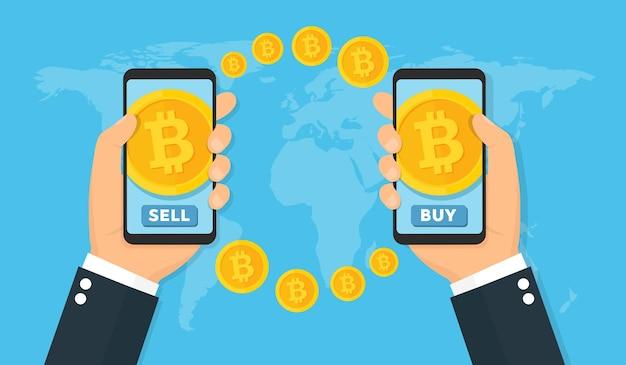 Mani che tengono smartphone con bitcoin sullo schermo