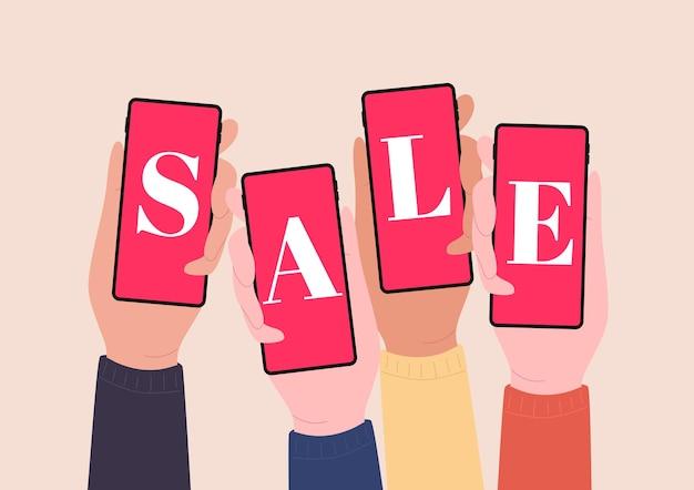 Mani che tengono gli smartphone e mostrano la vendita