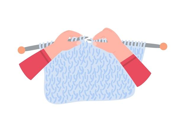 Mani che lavorano a maglia con aghi e filo piatto isolato su bianco
