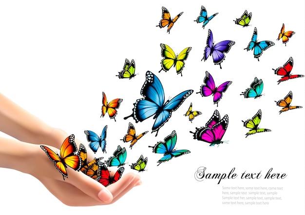 Mani che rilasciano farfalle colorate. illustrazione vettoriale