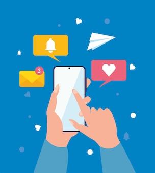 Mani che utilizzano le icone di messaggistica dello smartphone