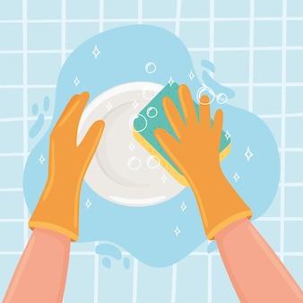 Mani che lavano un piatto