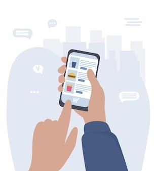 Le mani con lo smartphone effettuano acquisti online tramite applicazioni mobili
