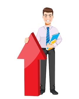 Uomo d'affari bello in piedi vicino alla grande freccia rossa personaggio dei cartoni animati di giovane uomo d'affari