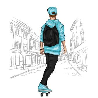 Bel ragazzo in abiti eleganti e skateboard