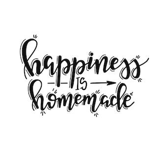 La felicità è fatta in casa sul poster di tipografia disegnato a mano