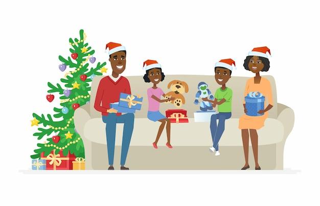 Regali di natale aperti della famiglia africana felice - illustrazione dei caratteri della gente del fumetto su fondo bianco. genitori e bambini seduti su un divano vicino a un albero decorato e scartare regali - giocattoli