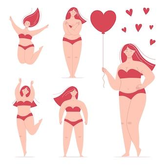 Una bella donna grassoccia felice in costume da bagno che tiene in mano un palloncino a forma di cuore che balla saltando