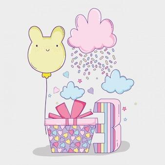 Decorazione di buon compleanno con nuvole e presente