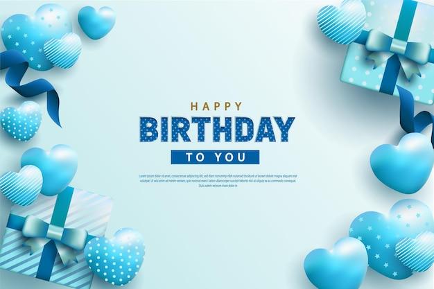 Buon compleanno su sfondo azzurro con decorazione realistica di nastri e scatole regalo