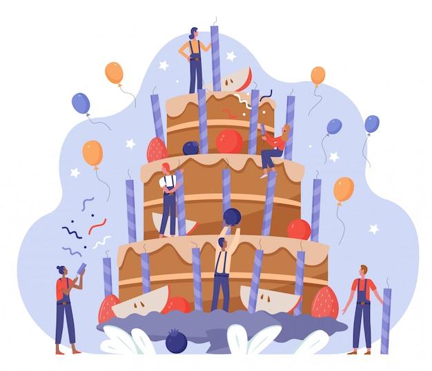 Buon compleanno. la squadra della gente decora l'illustrazione di vettore della torta di compleanno, personaggi piatti minuscoli del fumetto che lavorano insieme sulla grande torta della data di nascita della decorazione