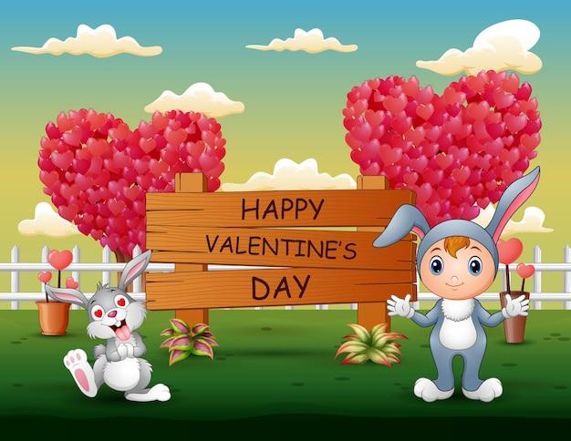 Coniglietti felici che celebrano un san valentino