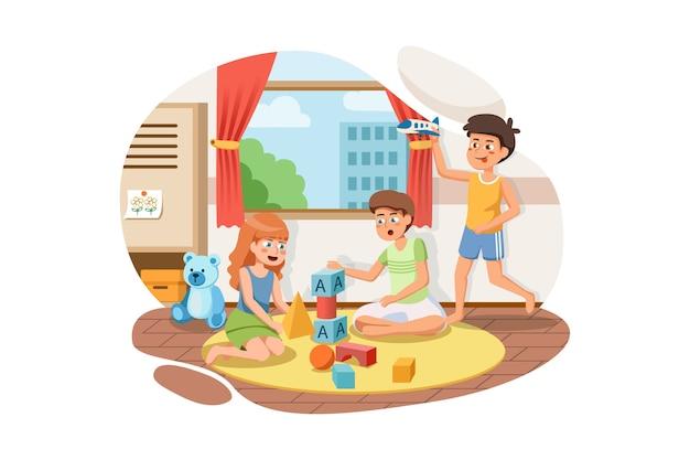 Gruppo di bambini felici che giocano insieme a blocchi di giocattoli e auto all'interno dell'aula.