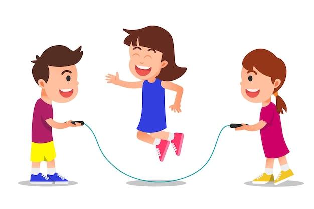 Bambini felici che giocano insieme alla corda per saltare