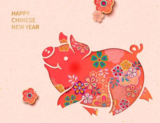 Felice anno nuovo cinese con adorabile porcellino floreale su sfondo rosa chiaro