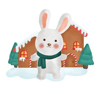 Cartolina di natale felice con un coniglio e una casa.