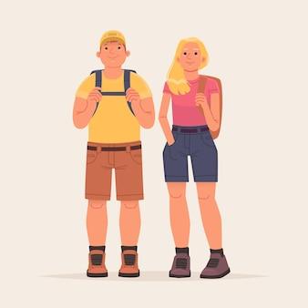 Coppia felice di turisti escursionisti su sfondo isolato vestiti con abiti da trekking