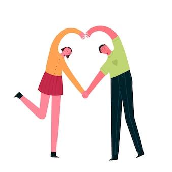 La coppia felice fa un cuore con le loro mani isolate.