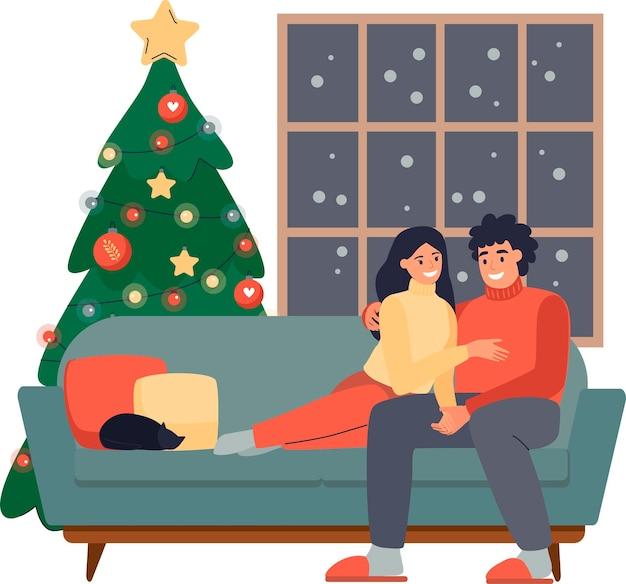 Coppie felici che si siedono e si abbracciano sull'accogliente divano insieme alla vigilia di natale