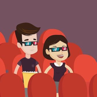 Coppie felici che guardano film 3d nel teatro.