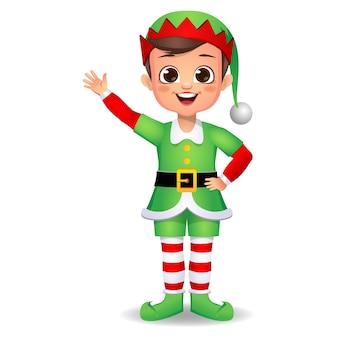 Felice ragazzo carino ragazzo che indossa un abito da elfo con agitando la mano