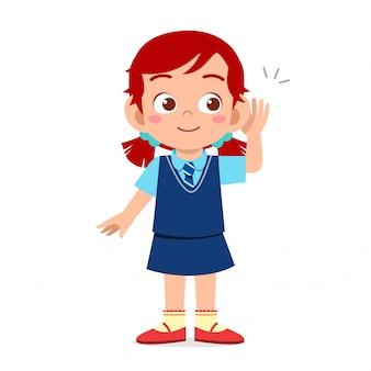 Ragazza felice del bambino sveglio pronta per andare a scuola