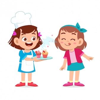 Bambini felici carini con cupcakes Vettore Premium