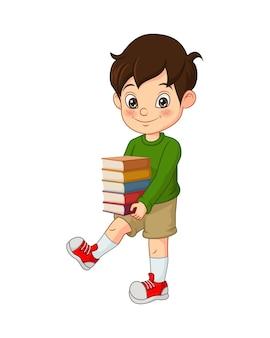 Felice carino ragazzino tenendo la pila di libri