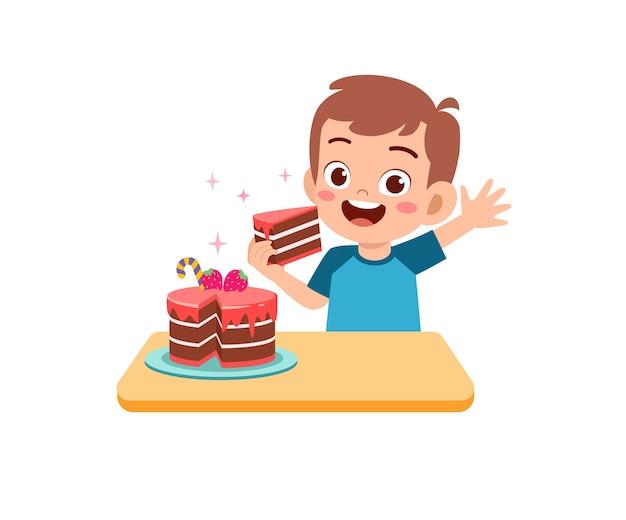 Felice carino ragazzino ragazzo mangia una torta di compleanno