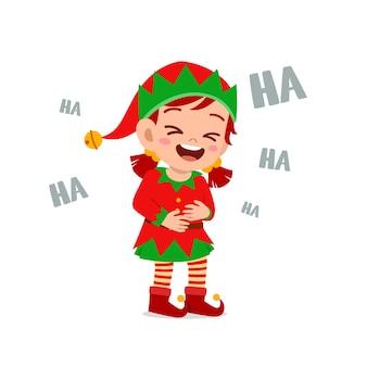 Felice carino ragazzino ragazzo e ragazza che indossa il costume di natale elfo verde e ridere forte