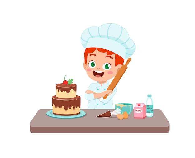 Felice carino ragazzino ragazzo indossa l'uniforme dello chef e cucina una torta di compleanno