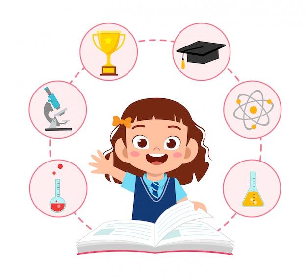 La ragazza sveglia felice della scuola del bambino ha letto il libro