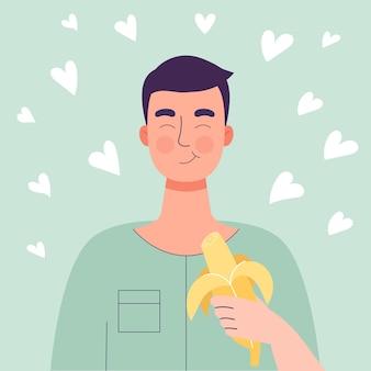 Uomo sveglio felice che mangia banana
