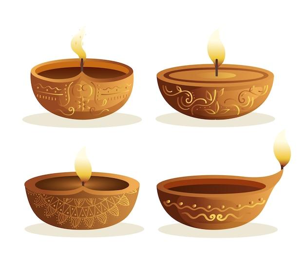 Candele di diwali felici messe isolate su bianco