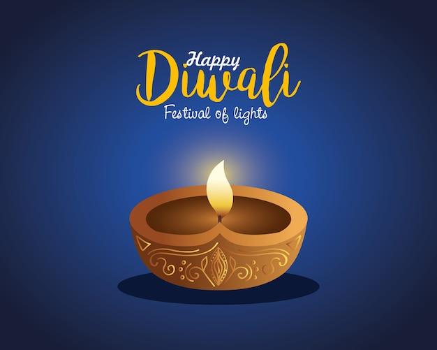 Carta di diwali felice con la candela sull'azzurro