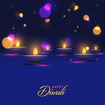 Carattere diwali felice con lampade a olio illuminate