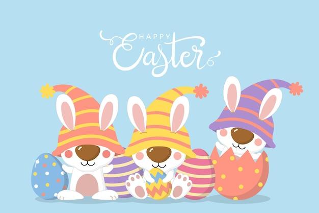 Saluto felice di giorno di pasqua con uova e coniglietto in costume da gnomi.
