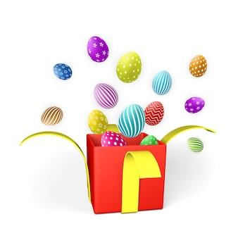 Felice giorno di pasqua con uova di pasqua e confezione regalo rossa